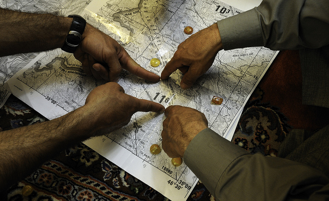 Hands pointing at a map