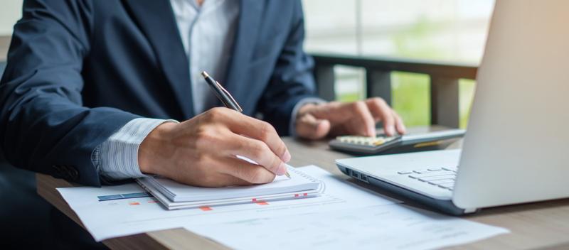 Accountant calculating taxes.
