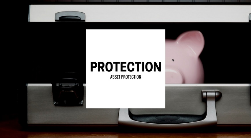 A piggy bank inside of a briefcase with the words Asset Protection on front.