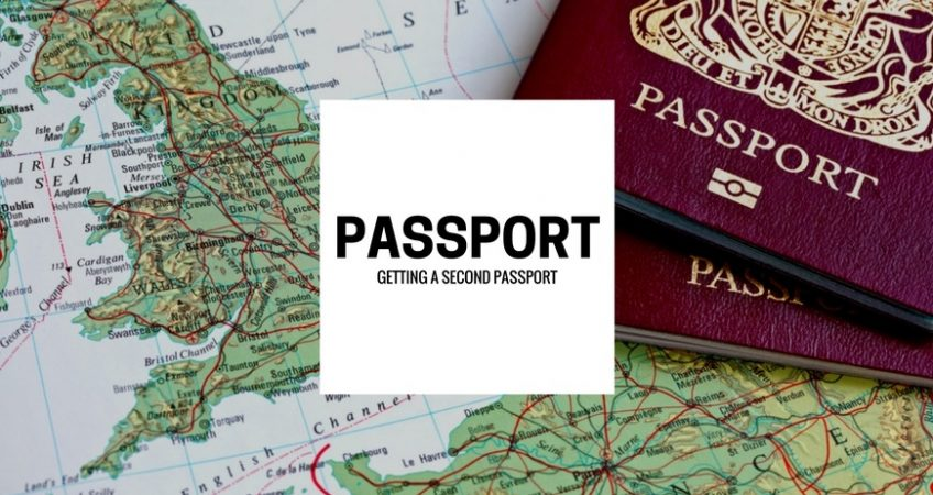 Two passports laying on top of a map.