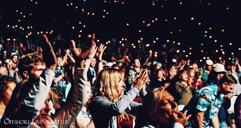 people celebrating at a concert
