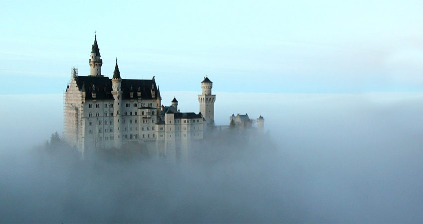 A castle that appears to be floating in the clouds