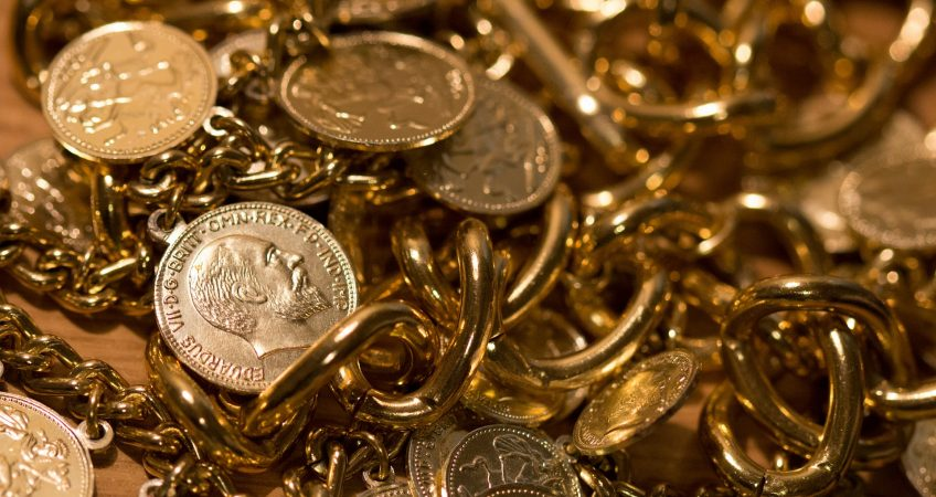 pile of gold coins and jewelry