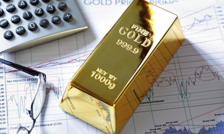 Gold bullion bar on a stocks and shares chart.