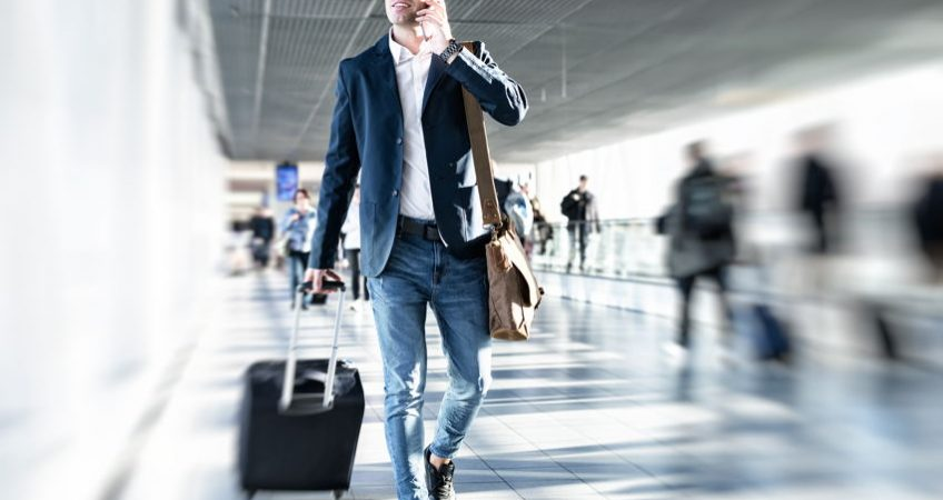 A businessman in a suit walking through an airport
