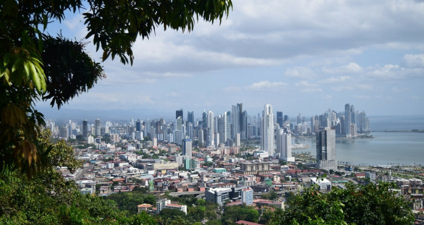 behind panama economy, a view form cerro ancon, the city lanscape and the sea