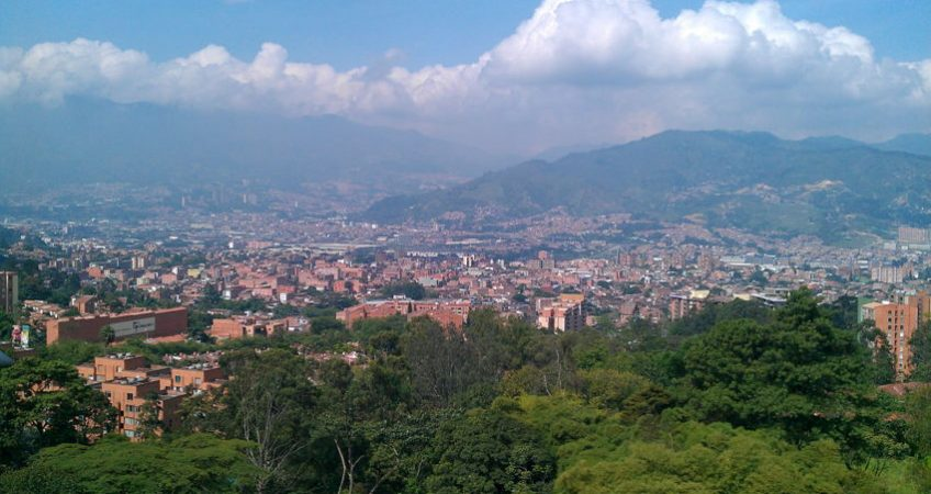 View out across the city of Medellin, Colombia. Mountains visable in background and lots of greenery