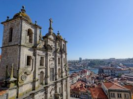 Old colonial building in porto portugal. View across the red topped houses of the city and out to the river