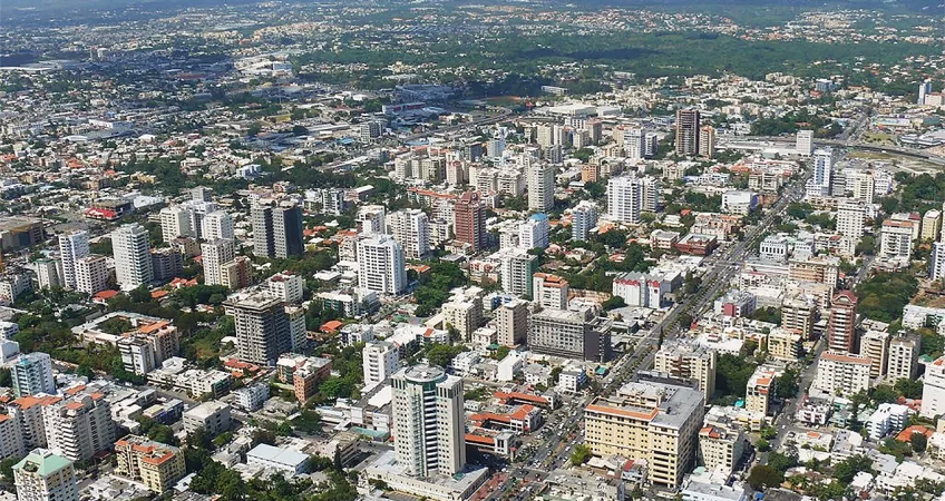Aerial view of santo domingo, in the Dominican Republic showing high rise appartments and the town. In the distance you can see some mountains
