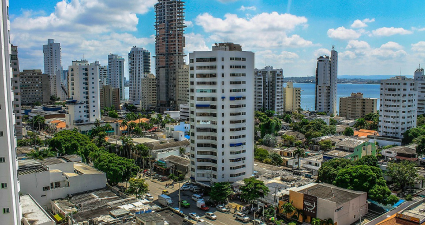 Back up residency in colombia. a high rise building in colombia with new developments being built in the background