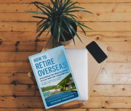 How To Retire Overseas book on a wooden floor