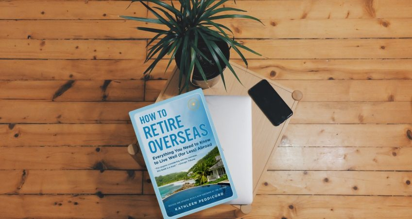 How To Retire Overseas book on a wooden floor