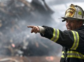 A firefighter pointing a location