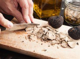 french black truffles on a chopping board