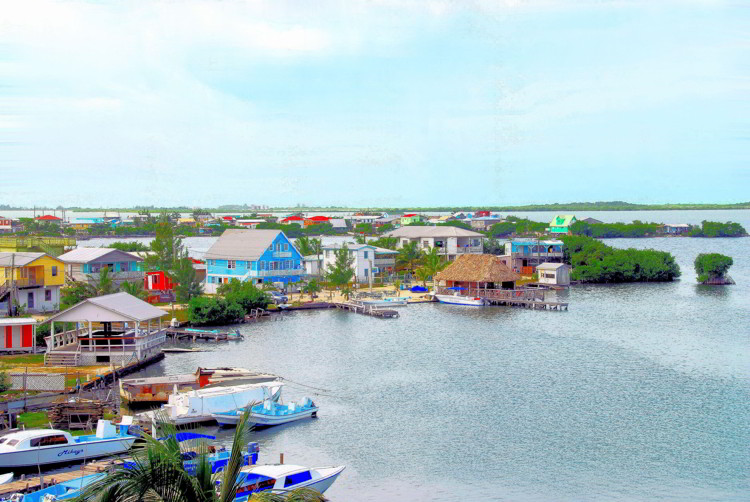 Many homes with boats are built close to the Caribbean Sea on the southern part of Ambergris Caye