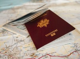 two passports laying on top of a map