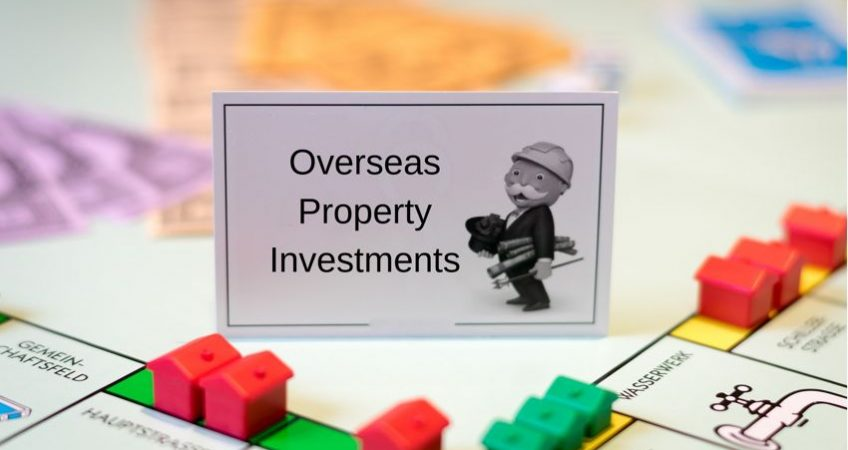 "A monopoly board with houses and hotels and a card that reads ""overseas property investments"""
