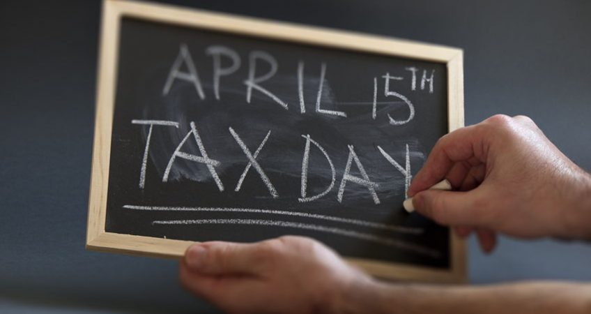 Blackboard with April 15 Tax Day written in big letters