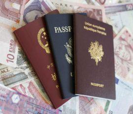 French, U.S. and Chinese passport on money