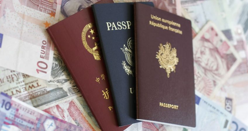 French, U.S. and Chinese passport on money