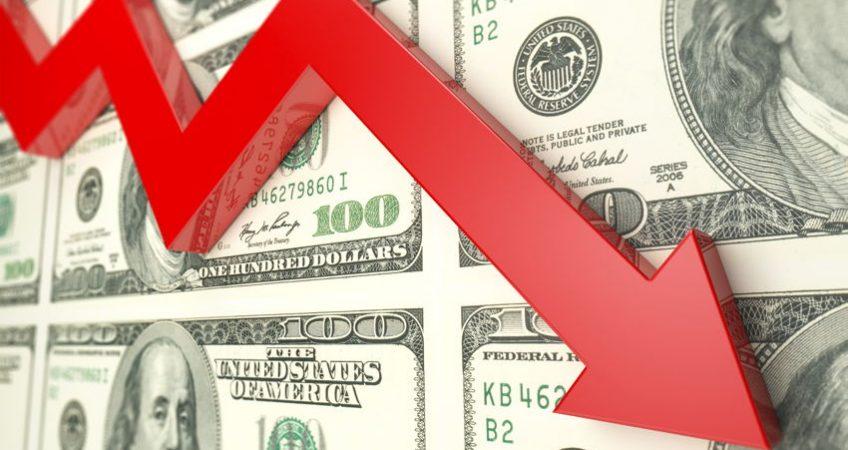Dollar bills and arrow going down