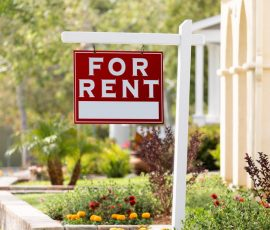 A for rent sign outside a nice property