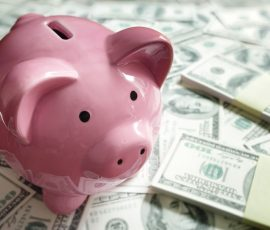 definition of wealthy piggy bank and cash
