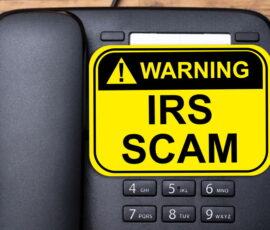 telephone with warning irs scam written on it