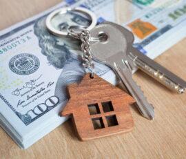 house keys on top of hundred dollar bills