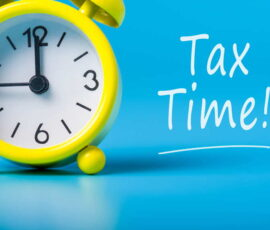 clock ringing with tax time logo next to it