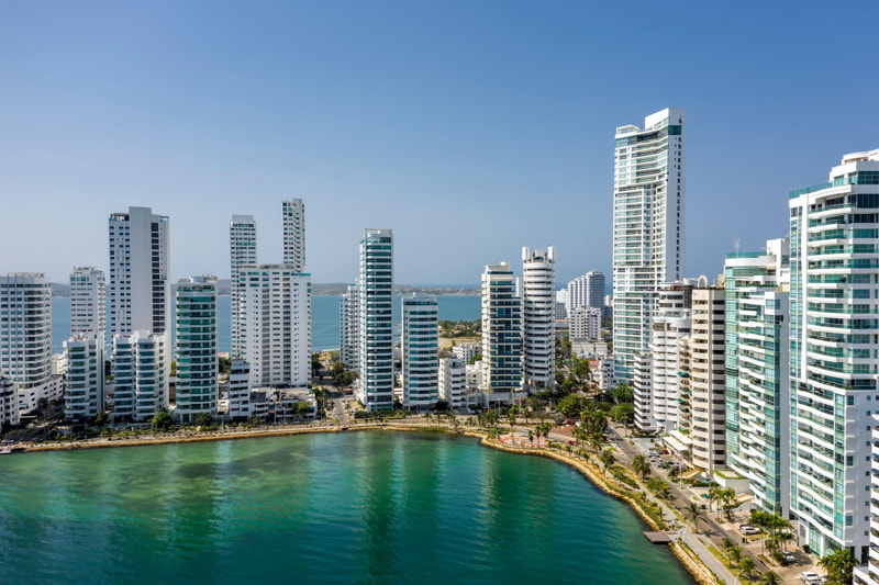 Aerial view of a skyline of white residential skyscrapers in Cartagena's prestigious Castillogrande district.