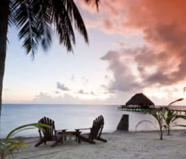 Beautiful tranquil beach sunrise in Southern Belize.