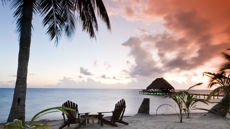 Beautiful tranquil beach sunrise in Southern Belize.