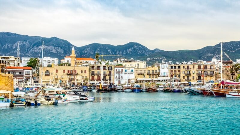 Kyrenia historical city center, view to marina with many yachts and boats and mountains in the background, North Cyprus