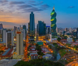 Colorful panorama of the skyline of Panama City at sunset with high rise skyscrapers, Panama.