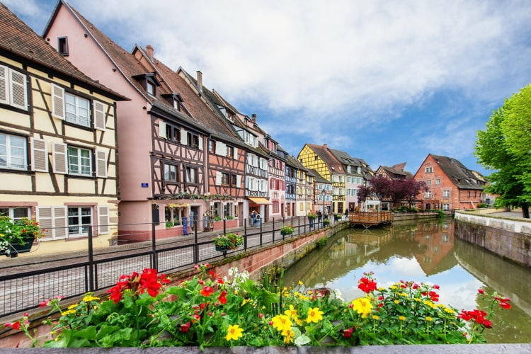 Colorful traditional French houses on the side of river Lauch in Petite Venise, Colmar, France.