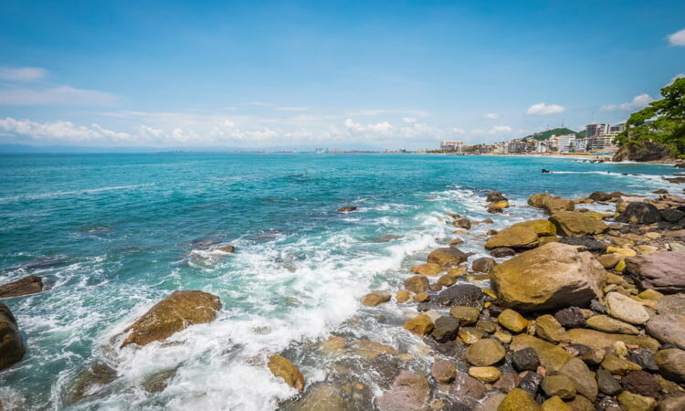 Rocky beach with blue waters in Puerto Vallarta, Jalisco, Mexico.