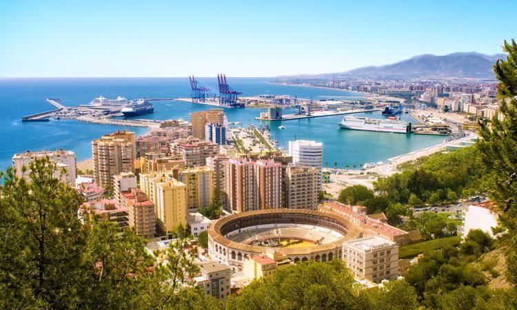 View of Malaga with bullring and harbor