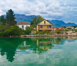 House by sea on cloudy day in Tivat, Montenegro.